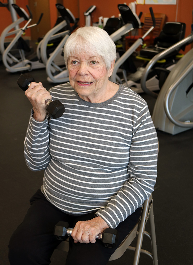Woman exercising in MAC's Wellness Center